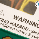 A close-up of a toy package's choking hazard warning label