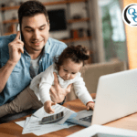 Dad working from home while on the phone and holding his antsy toddler