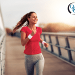 Young woman smiling and jogging across a bridge