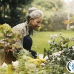An older woman tending to her backyard garden of flowers