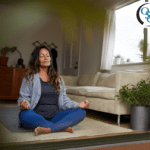 A woman calmly meditating on the floor of her living room