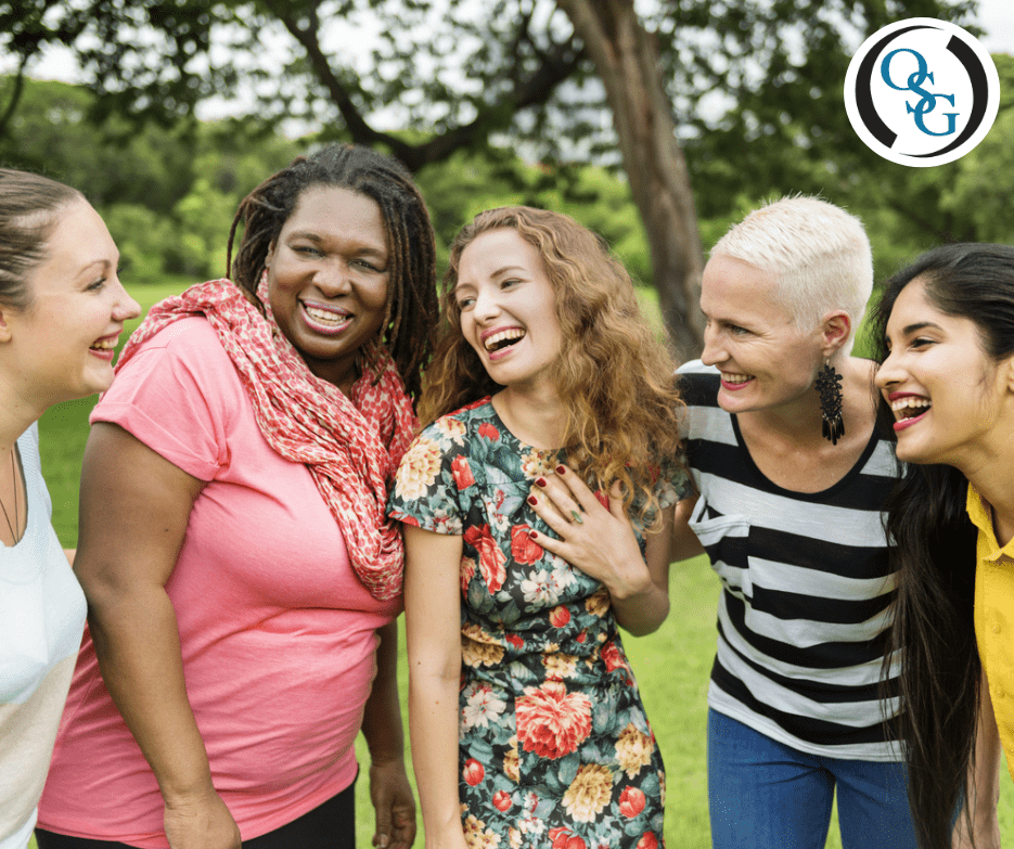 A group of diverse women smiling and laughing with eachother